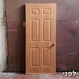 דלת פנים עם מנעול פאבלוק לפני צביעה